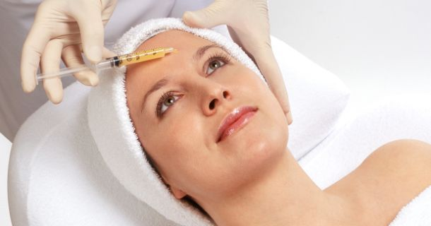 prp treatment being administered, injected into patient's face, med spa service