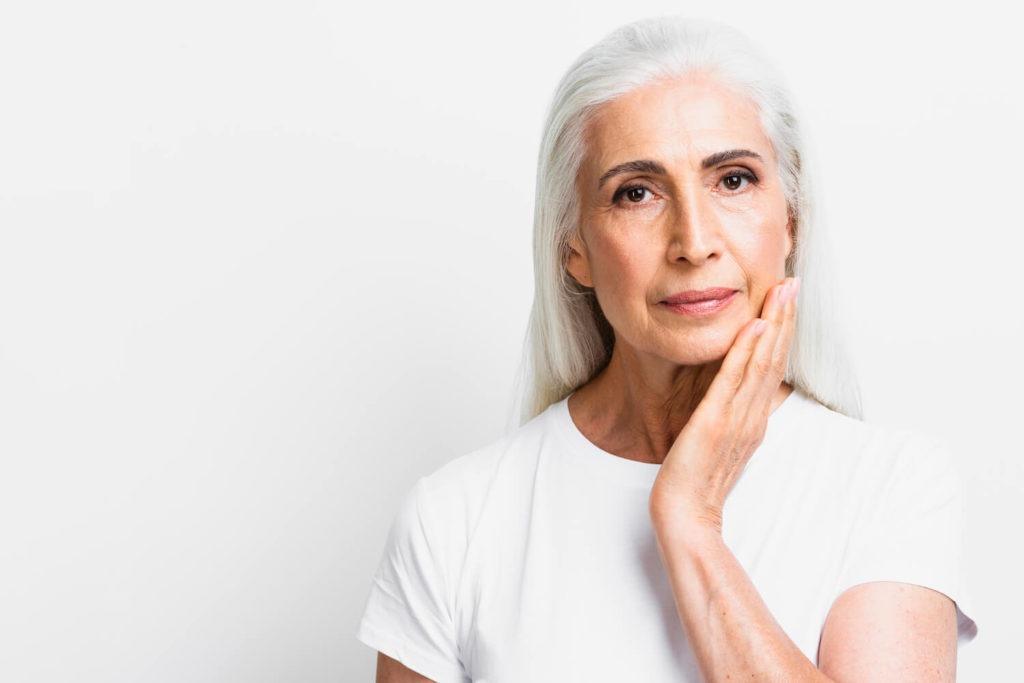 senior woman with glowing skin, skin rejuvenation