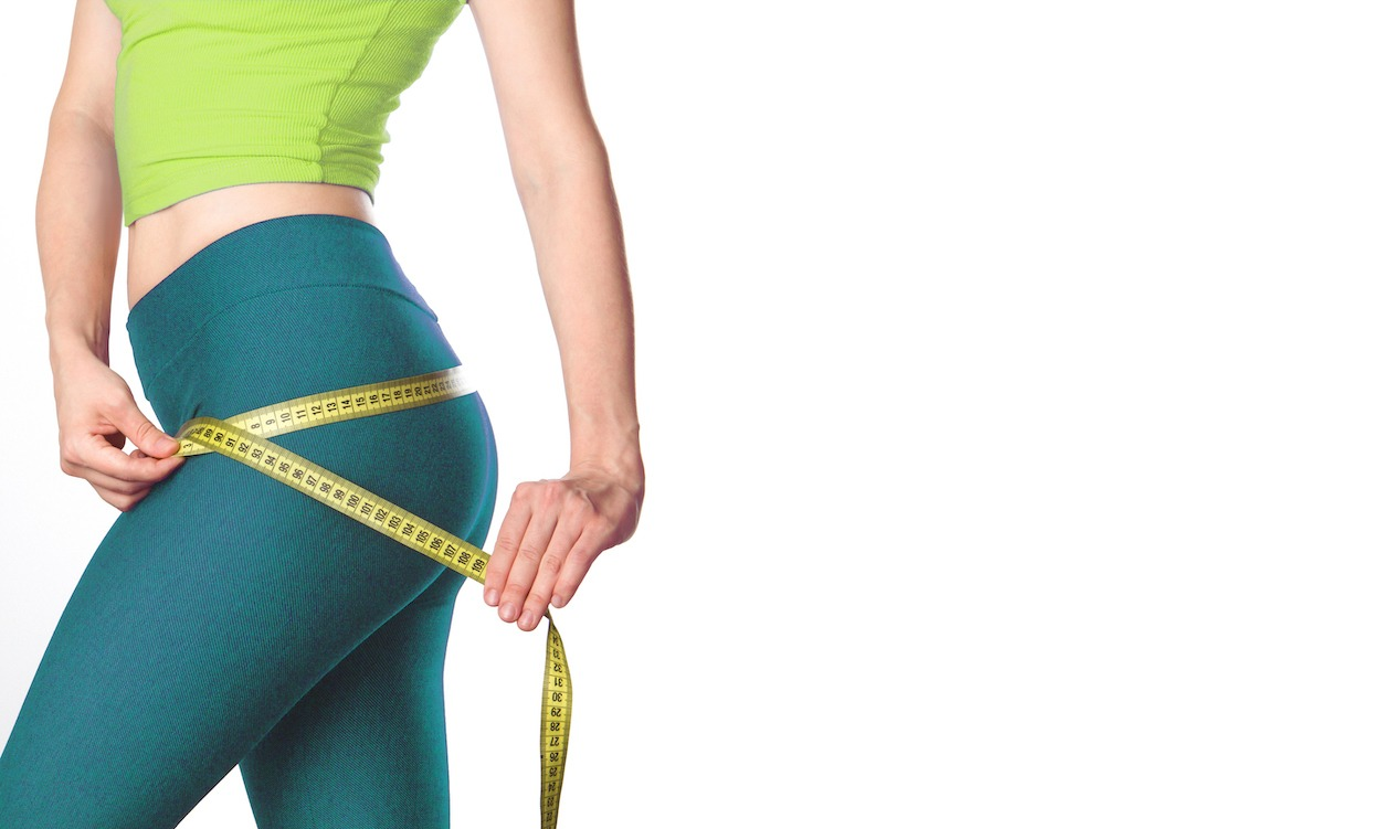 woman measuring her body contouring weight loss