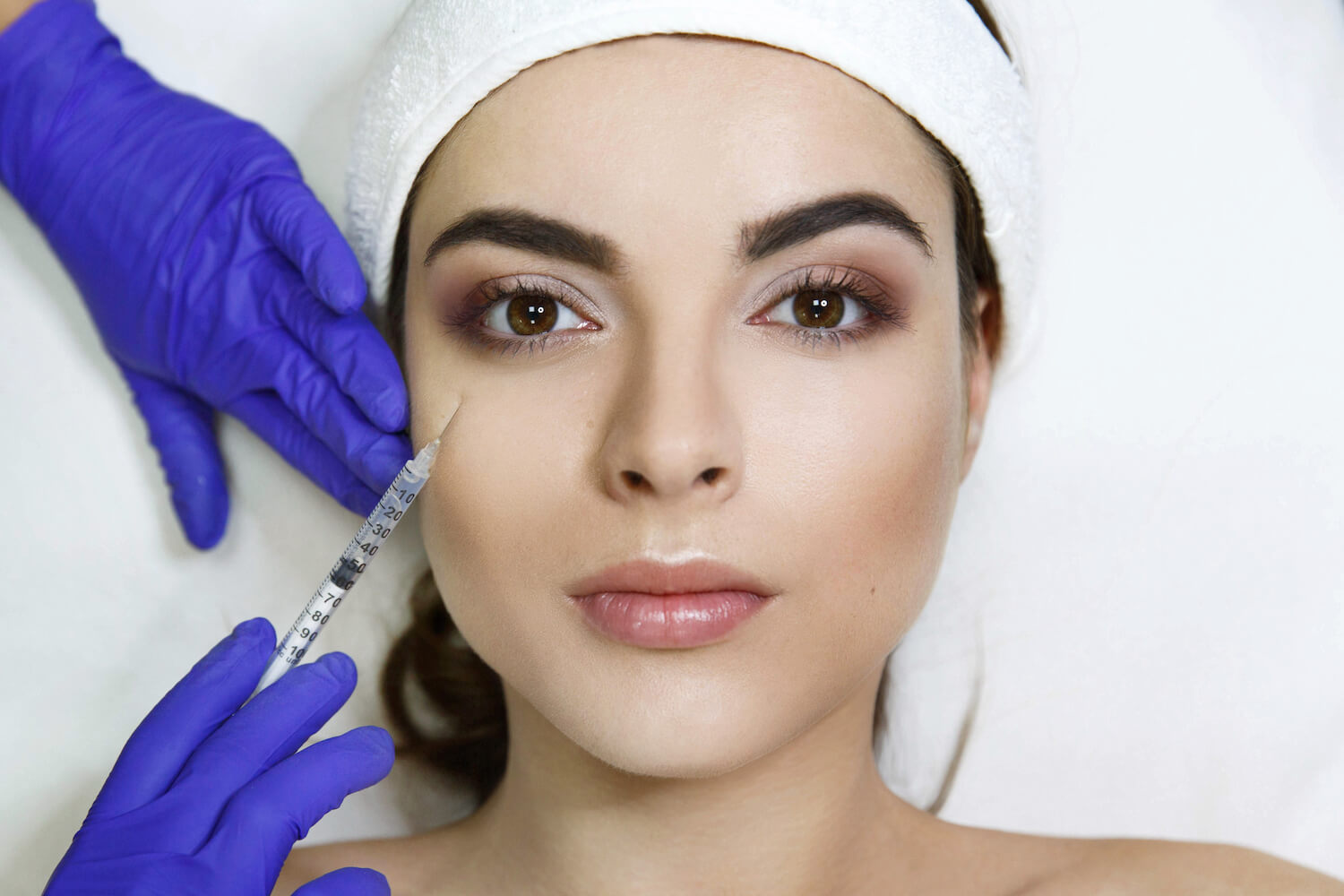 woman receiving botox injection, med spa service