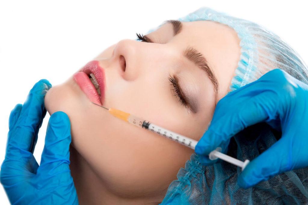 woman receiving injection, platelet rich plasma treatment