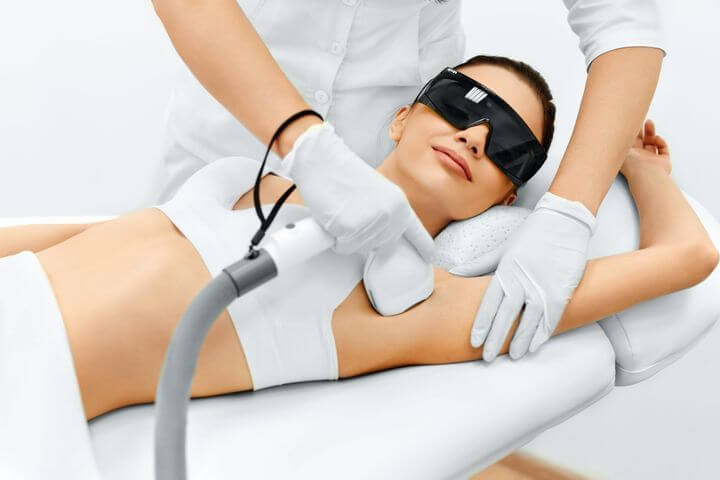 woman receiving laser hair removal, med spa service