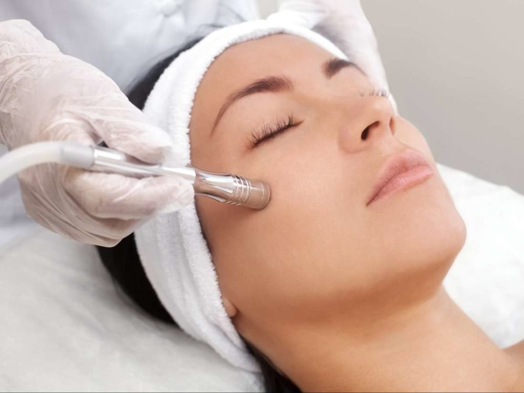 woman receiving microdermabrasion treatment, med spa service