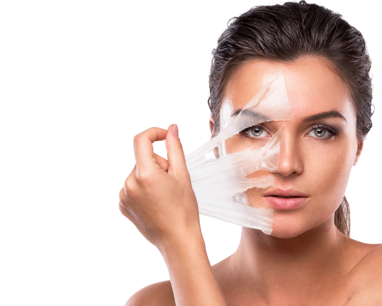 young woman pulling off chemical peel from face, rejuvenating skin