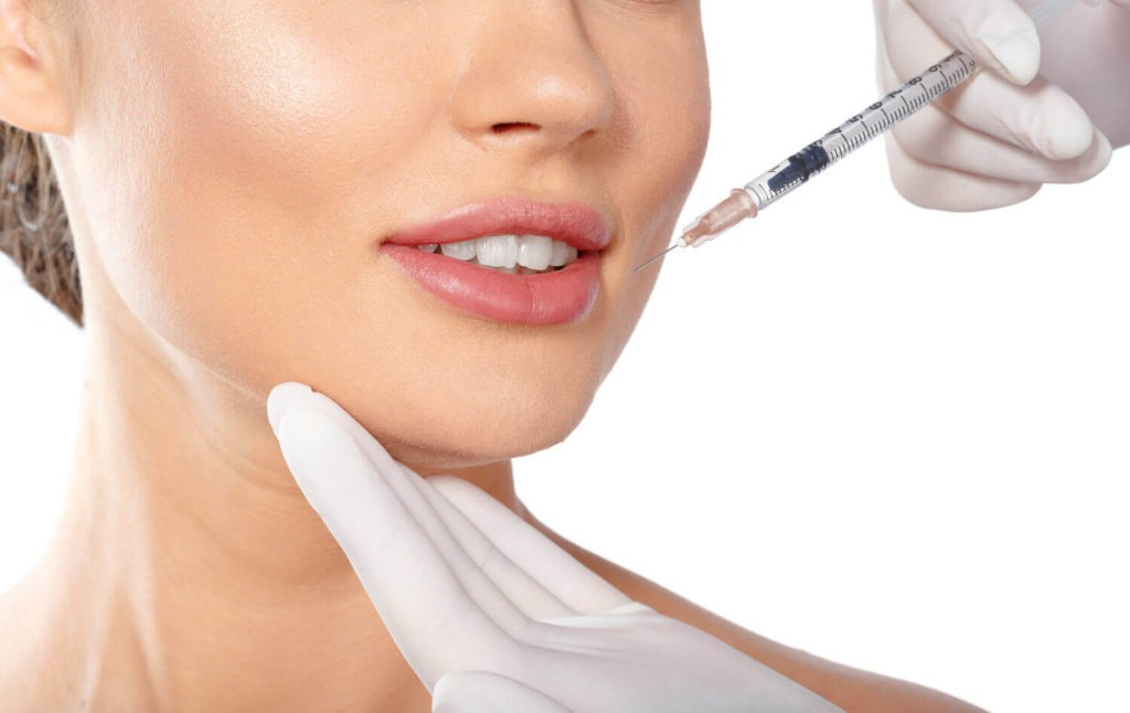 young woman receiving botox injection in face